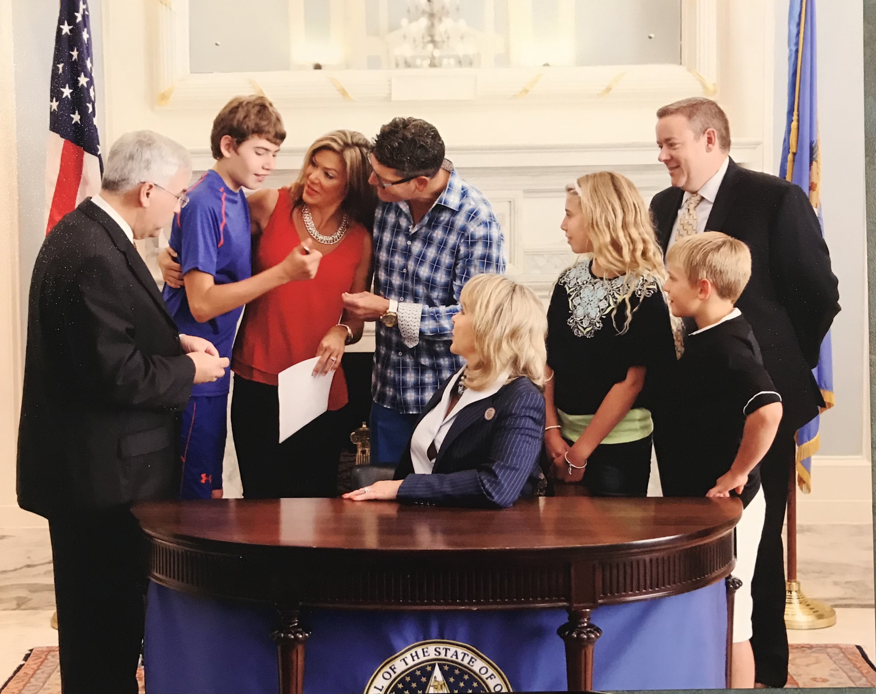 signing of Katie and Cayman's law 2015